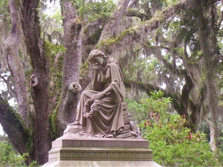 somber: Somber statue in Savannah cemetary beneath the Spanish Moss