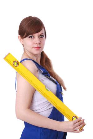 Hübsche junge Frau mit Wasserwaage Standard-Bild - 30652033