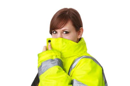 Frau trägt eine reflektierende Jacke Standard-Bild - 30675777