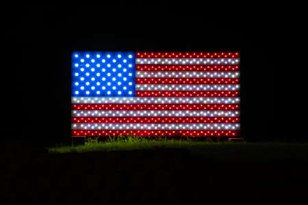 Photography of a LED lit up structure displaying the US flag