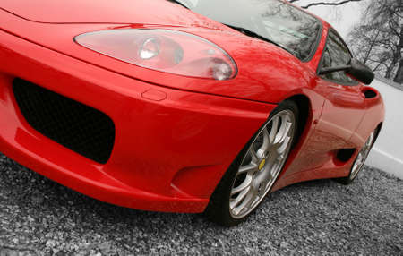 valet: Bright red sports car on a black and white background