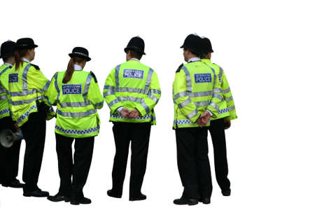 Group of UK Metropolitan police officers isolated on a white background