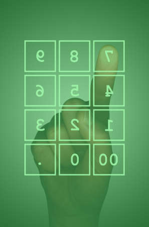 Green touch screen numeric keypad and hand photo