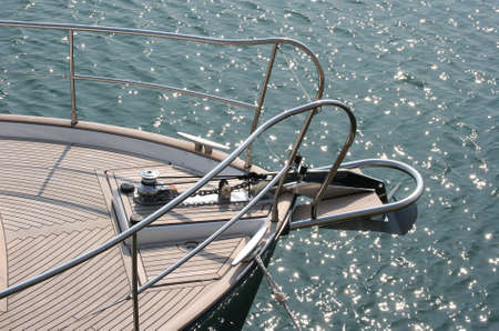 yachtsman: Sail boat bow with glistening water