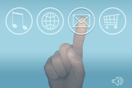 selecting: Finger selecting email icon on a computer touch screen