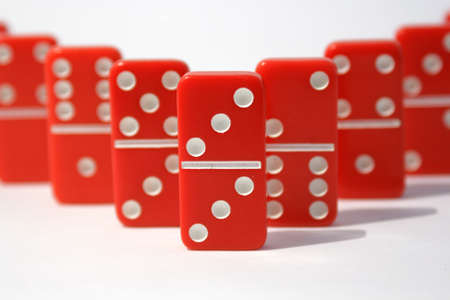 Red dominoes on a white background photo