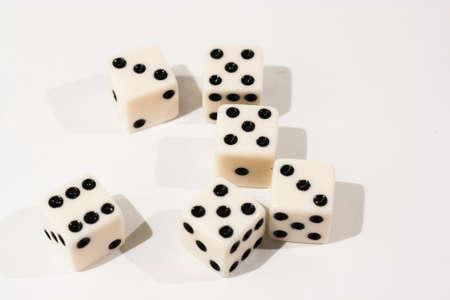 White dice shot against a white  photo