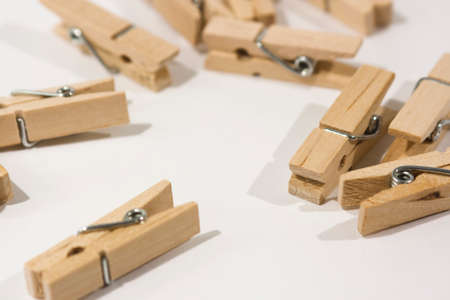 pegs: Wooden clothes pegs scattered on a table