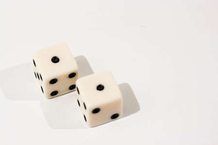 White dice shot against a white background photo