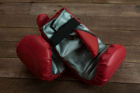 pair of boxing gloves on a wooden floor Stock Photo