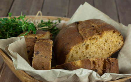 paper basket: Loaf of wholemeal bread in a basket with brown paper Stock Photo