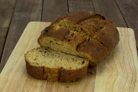 Loaf of wholemeal brown bread cut ready to serve Stock Photo