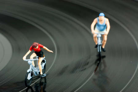 Model people having a cycle race on a record