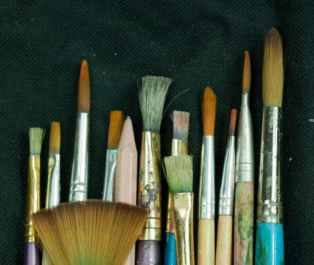 Artist paint brushes in thier pouch read for use