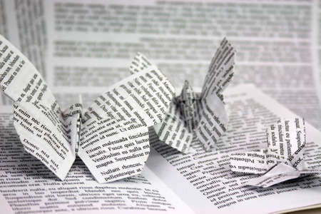 craft background: Origami butterflies with words coming out of a book. Lorem Ipsum test used.