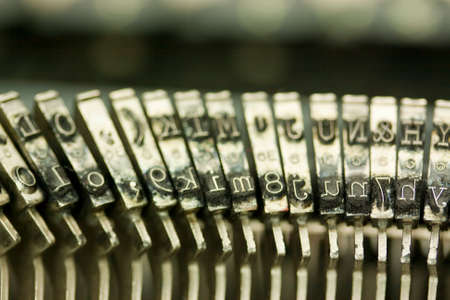 type writer: Close up of hammer keys on an old type writer. Shallow depth of field.