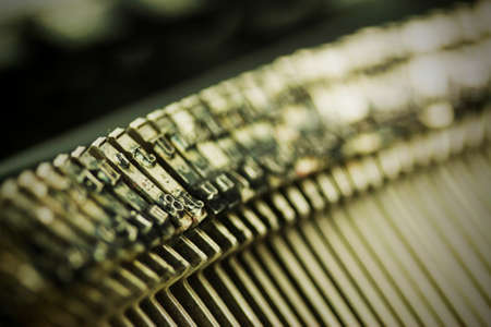 type writer: Close up of hammer keys on an old type writer. Shallow depth of field. Vintage style filter applied.
