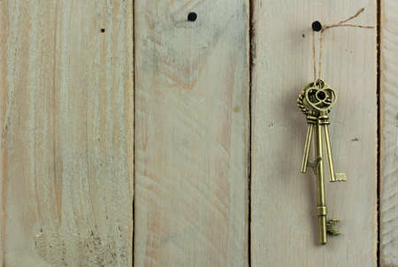 antique keys: Set of old antique keys on a wooden background.