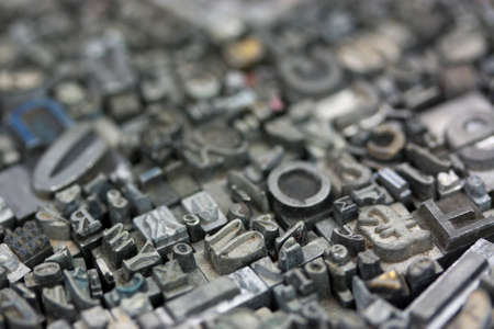 old letters: Close up of old used metal typeset letters Stock Photo