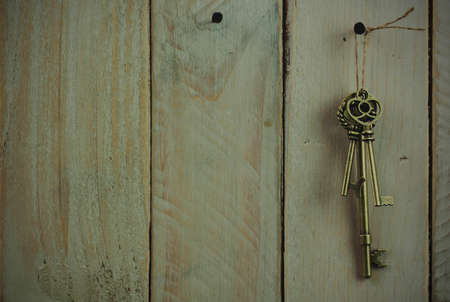 antique keys: Set of old antique keys on a wooden background. Vintagefilter applied.