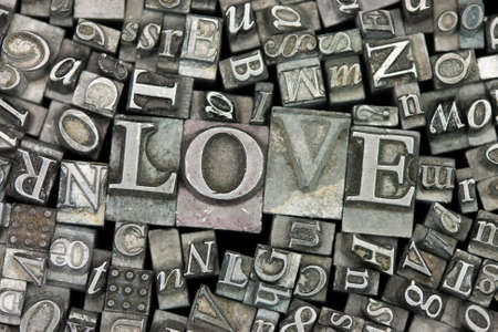 typeset: Close up of old used metal typeset letters with the word Love. Stock Photo