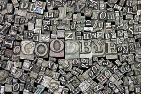 Close up of old used metal typeset letters with the word Goodbye