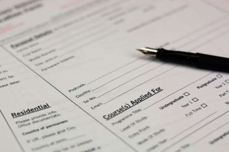 Close up of a fountain pen on a university application form