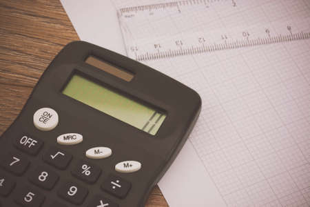Calculator And Drawing Equipment And Graph Paper On A Table Stock