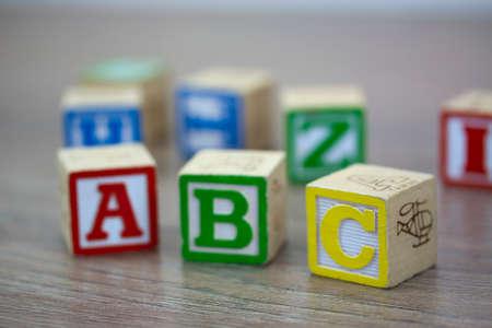 play blocks: Childrens play blocks on a wooden floor Stock Photo
