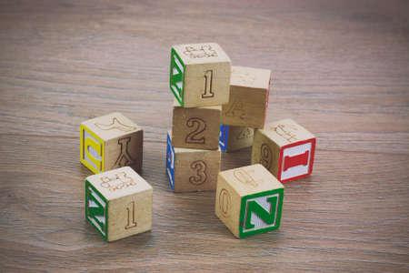 play blocks: Childrens play blocks on a wooden floor. Retro filter applied.