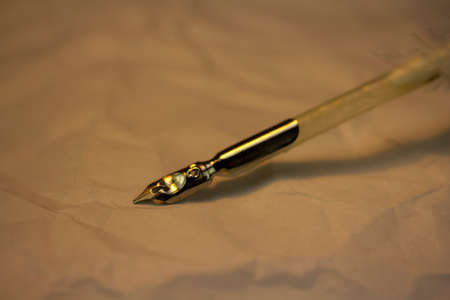 feather quill: White feather quill pen with metal nib