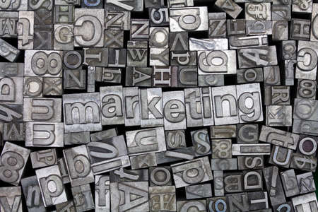 typeset: Close up of old used metal typeset letters with the word marketing Stock Photo
