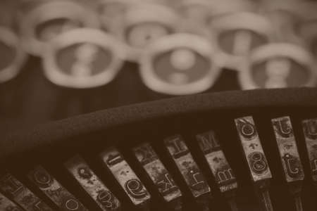 type writer: Close up of keys on an old vintage type writer. Black and white filter applied.