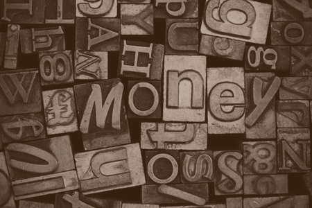 typeset: Close up of old used metal typeset letters with the word money Stock Photo