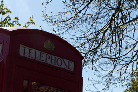 red telephone: Old fashioned red telephone box in a country village