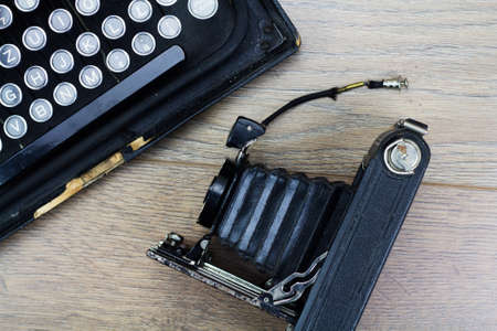 bellows: Overhead image of an old fashioned vintage typewriter with bellows camera