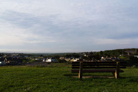 empty bench: Empty bench over looking the countryside from Bude, Cornwall Stock Photo