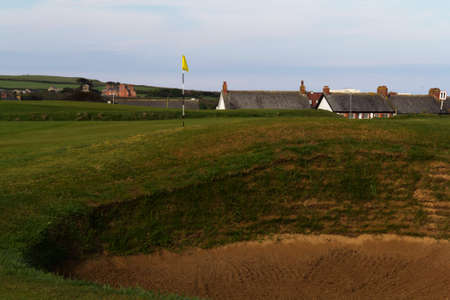 bunker: Bunker on golf course with green behind