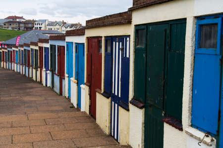 disused: Old disused beach huts on the seafront in Bude