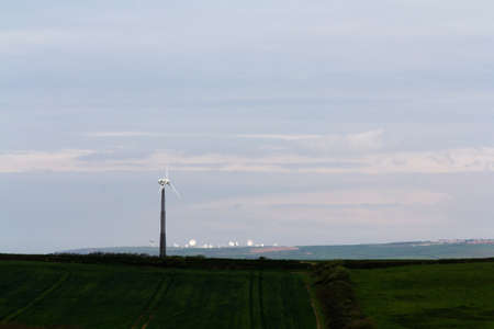 satelite: Windmill in the Cornish countryside with satelite dishes in background Stock Photo