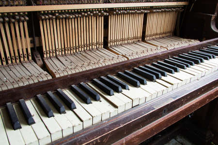 disused: Old broken disused piano with damaged keys