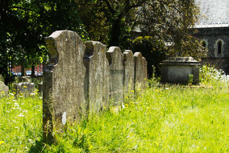 Grave stones outside a church in Beaconsfield, Buckinghamshire, England Banco de Imagens