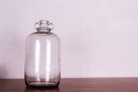 demijohn: Clear glass demijohn against a light background