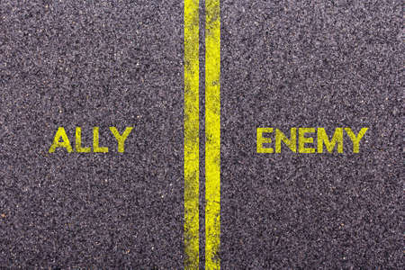 an ally: Tarmac background with the words ally and enemy
