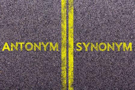 synonym: Tarmac background with the words antonym and synonym