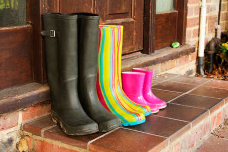 wellie: Colourful wellington boots left outside on a doorstep