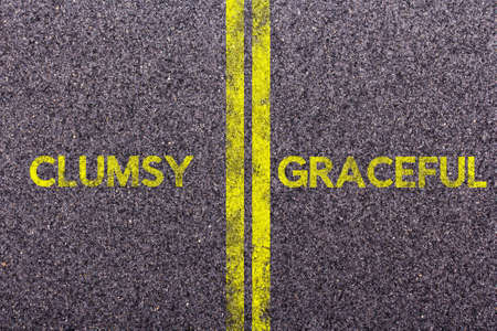 clumsy: Tarmac background with the words clumsy and graceful
