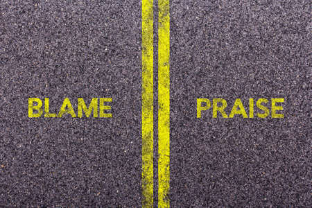 blame: Tarmac background with the words blame and praise