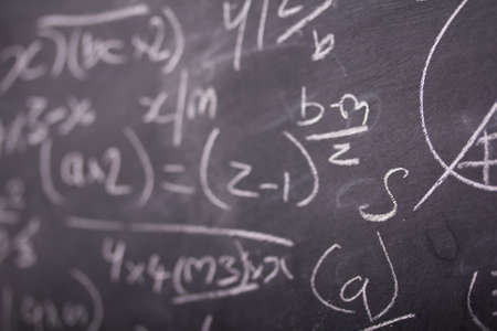 equations: Close up of blackboard with maths equations and sums Stock Photo