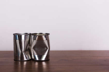 tin cans: Battered tin cans on a rustic wooden background